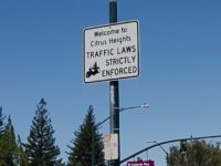 A traffic sign on Sunrise Boulevard advises drivers that Citrus Heights traffic laws are strictly enforced. One method used by police in the city is red light cameras. // CH Sentinel