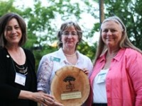 """Citrus Heights Vice Mayor Sue Frost (left) and council member Jeannie Bruins (right) accept the 2014 """"Growing Greenprint"""" award from the Sacramento Tree Foundation. // Photo courtesy of City of Citrus Heights."""