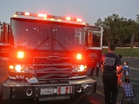 Firemen from Engine 21 show off their truck to residents outside of Skycrest Elementary, Wednesday night.