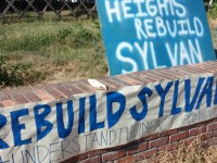 Signs nearby Sylvan Middle School in Citrus Heights advocates for rebuilding the school, rather than moving or repairing it.