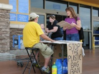 Citrus Heights residents Kathleen Ring and daughter Randi sign a plastic bag petition outside Walmart, Thursday.