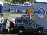 """Drivers grab coffee during Wednesday's """"Proceeds Day"""" at Dutch Bros. Coffee in Citrus Heights."""