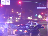 Officers assess collision, Thursday night. Injuries are unknown at this time.