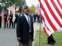 Jerry Smith of American Legion Citrus Heights Post 637 walks in front of the Honor Guard during the Veterans Day event.
