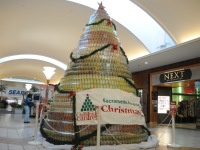 """A Christmas """"tree"""" made of donated food cans will be on display at Sunrise Mall through December 27."""