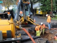 Citrus Heights Water District workers block off intersection of Mariposa Avenue and Cook Lane to repair a damaged water main, Thursday.