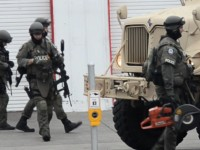 Citrus Heights SWAT members exit S&S Tire after a Tuesday morning weapons-related raid.