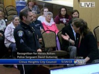 """Citrus Heights Mayor Sue Frost speaks to police Sgt. David Gutierrez during a May 14  council meeting where the sergeant was recognized for """"heroic actions."""""""