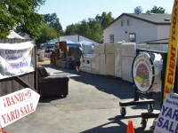 Signs at the entrance advertise the Citrus Heights Community Marching Band's annual Fall Yard Sale fundraiser.