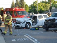 Metro Fire personnel respond to a head-on vehicle collision on Sylvan Road, Thursday. // CH Sentinel