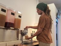 Austin Lynch, manager of a new organic cafe in Citrus Heights, pours a glass of kombucha.