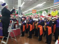 Citrus Heights Community Marching Band members play seasonal tunes during a flash mob performance at the Citrus Heights Walmart on Saturday. // CH Sentinel