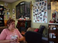 Louise Hansen-Cordray, owner of Java Cherry in Citrus Heights, chats with a customer after serving up a cup of coffee.