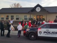 Officers drop off items to kids at the Sayonara Center during the 2016 Holiday Referral gift drop-off. // CH Sentinel