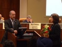 Newly seated Mayor Jeff Slowey reads a proclamation honoring outgoing councilwoman Sue Frost (right). // CH Sentinel