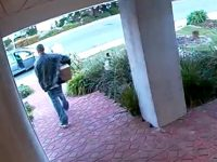Surveillance footage from a homeowner video shows a theft suspect walking off with a stolen package.