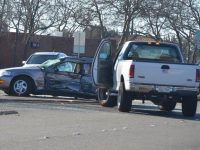 An Acura sedan involved in a fatal collision on Thursday could be seen with significant side impact damage after being hit by a truck. // CH Sentinel
