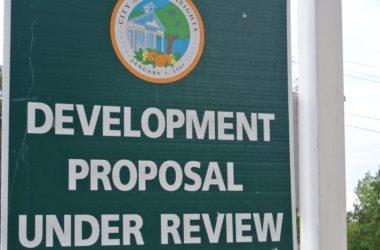Development proposal under review sign