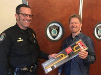 Citrus Heights police Tweeted a photo of Officer Anthony Boehle handing out a steering wheel lock, Wednesday. // Courtesy, CHPD