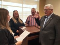 Newly appointed Citrus Heights Councilman Albert Fox is sworn in by City Clerk Amy Van on Friday, as Vice Mayor Steve Miller and Councilwoman Jeannie Bruins look on. // CH Sentinel