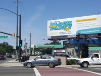 A large billboard advertises the city's upcoming Block Party to celebrate 20 years of cityhood. // CH Sentinel
