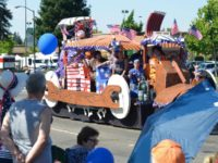 The Harmer family's Flintstones-themed float won the 2017 Mayor's Award during the Red, White and Blue Parade. // CH Sentinel