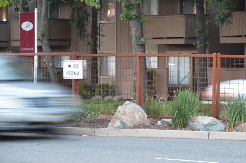 Barrier fence, pedestrians, Citrus heights