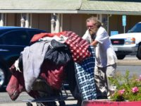 File photo, a homeless man pushes a shopping cart along Greenback Lane. // CH Sentinel