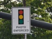 File photo, red light camera sign. // CH Sentinel