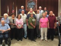 A group of 12 of the city's top 20 longest residents gathers for a photo with the Citrus Heights city council on Aug. 10, 2017.