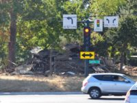 Cars fly by the site of an abandoned home that was recently demolished on Sunrise Blvd. // Citrus Heights Sentinel