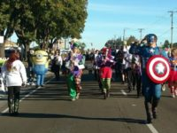 Citrus Heights Community Marching Band members travel along Auburn Boulevard on Saturday during the annual Howl-o-Ween Parade. // Image credit: Supervisor Sue Frost