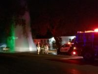 A 50-foot geyser of water from a broken fire hydrant on Old Auburn Road sprays into the air Sunday night as firefighters wait for a water district technician arrive. // Citrus Heights Sentinel