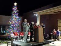 Citrus Heights Vice Mayor Steve Miller stands in front of the city's Christmas tree during a Dec. 7 tree lighting ceremony, joined by other council members and the city manager. // CH Sentinel