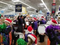Citrus Heights Community Marching Band members conduct a flash mob performance inside Walmart on Dec. 2, 2017.
