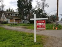A boarded-up home at 7716 Old Auburn Road now sits with a real estate sign in front of it, after it was removed from public auction. // CH Sentinel