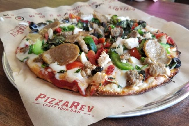 A craft-your-own pizza from the Citrus Heights PizzaRev, piled high with extra toppings.