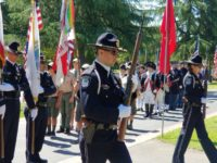 Members of the Citrus Heights Police Department's Color Guard head up a Memorial Day March at Sylvan Cemetery on Monday. // CH Sentinel