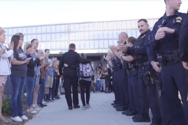 Video posted by the Sacramento County Sheriff's Department shows officers lined up to welcome slain Deputy Mark Stasyuk's little sister back to school on Friday.