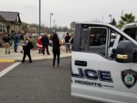 Police and city staff drop off gifts to kids at the Sayonara Center on Thursday. // CH Sentinel