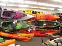 Colorful kayaks are on display inside Kayak City's showroom in Citrus Heights. //  Image credit: Thomas Sullivan