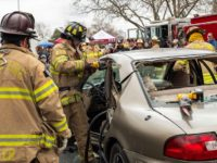 Metro Fire crews demonstrate extrication procedures during a safety fair outside Sunrise Mall on Saturday. // Image credit, Metro Fire